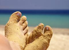 Detail women feet encasement sands on exotic beach Stock Photos