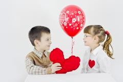 Boy and girl watch and smiling Stock Photos