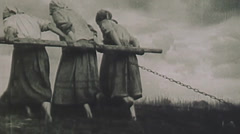 Low angle of three women pulling plow. circa 1931 Stock Footage