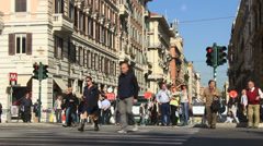 Locals & tourists at zebra crossing in Rome Stock Footage