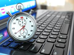 stopwatch on laptop keyboard. - stock illustration
