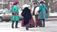 Group of actors in ancient dress smoking on street Stock Footage