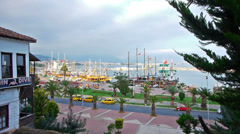 Beautiful view of resort city with boats in bay, Alanya Stock Footage