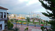 Stock Video Footage of Beautiful view of resort city with boats in bay, Alanya
