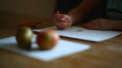 Girl hands drawing still life with fruits, aplle, mandarin, pear Stock Footage