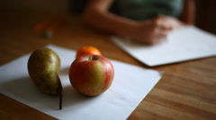 Girl hands drawing still life with fruits Stock Footage