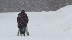 Woman with rollator/walker in the snow Stock Footage