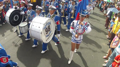 Blue Band Marching with flag waver overhead shot Stock Footage