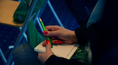 Hands of the correspondent. In hands pen and notebook. - stock footage