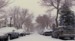 View down middle of Snowy unplowed Suburban street scene minneapolis, mn Stock Footage