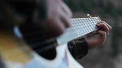 Close Up Of Cute Teen Outdoors In A Hoody Softly Strumming Her Guitar Stock Footage