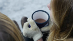 Over The Shoulder View of Teenage Girls With Mittens And Hot Chocolate Stock Footage