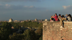 Young man on mobile phone, Rome city in background Stock Footage