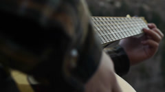 Close Up Of Teenage Girl Strumming Her Guitar Outdoors Stock Footage
