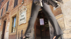 Woman walks past famous Babingtons Tea Rooms in Rome Stock Footage