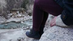 Profile of Teenage Girl Sitting High Above An Alpine Creek Stock Footage