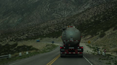 Truck Dangerously Passes Vehicle on Narrow Andes Highway Stock Video Stock Footage