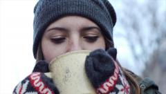 Cute Teen With Beanie And Mittens Sips Hot Chocolate And Smiles - stock footage
