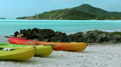 Antigua Jolly Beach 110, orange and yellow banana boats lying on the sands Stock Footage