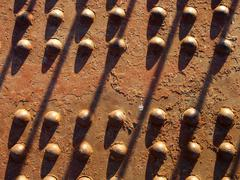 Rusted rivets of an old car bridge - stock photo