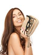Lovely woman with small handbag Stock Photos