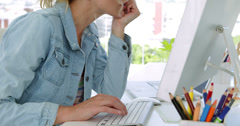 Blonde young designer working at the desk Stock Footage