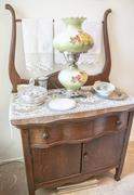 Antique dresser and lamp - stock photo
