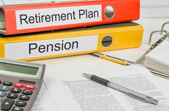 Folders with the label retirement plan and pension Stock Photos