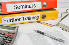 folders with the label seminars and further training - stock photo