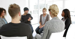 Blonde young woman sharing her problems - stock footage
