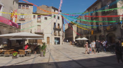 Small Town European Town Square with Streamers and People in Timelapse Stock Footage
