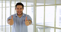 Cheerful businessman showing thumbs up Stock Footage