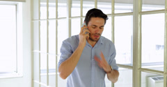 Annoyed young man having a phone call Stock Footage