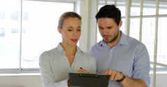 Young attractive colleagues working together on a tablet Stock Footage