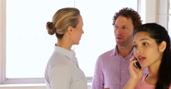 Content coworkers chatting - stock footage