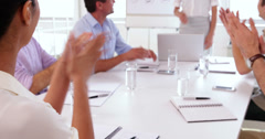 Business team applauding after a presentation - stock footage