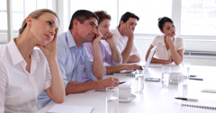 Bore business team sitting around the table - stock footage