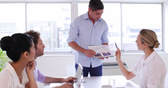 Businessman presenting chart to business team Stock Footage