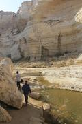 Walking into Ein Avdat and Nachal Zin Natural Reserve - stock photo