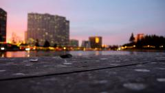 Lake Merrit skyline from dock at dusk Stock Footage