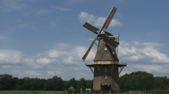 Dutch Windmill, gristmill in operation in rural landscape Stock Footage