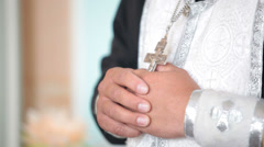 Hands of the priest with a crucifix - stock footage