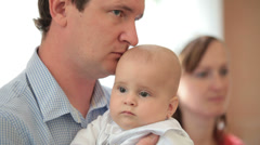 Father with  baby in her arms on ceremony of baptism Stock Footage