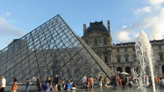The Louvre Pyramid crowded by tourists, Paris, France (LOUVRE PYRAMID-1A) Stock Footage
