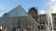 Stock Video Footage of The Louvre Pyramid crowded by tourists, Paris, France (LOUVRE PYRAMID-1A)