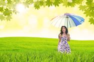 Stock Illustration of beautiful woman holds umbrella in green field