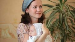Mother with a baby on hands Stock Footage