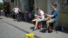 young kids teenagers play drum rhythm and public people - stock footage