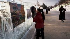 Krasnoyarsk, russia - jan 18, 2014: exhibition of paintings winter theme. fes Stock Footage