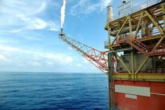 The offshore drilling oil rig platform from side view Stock Photos